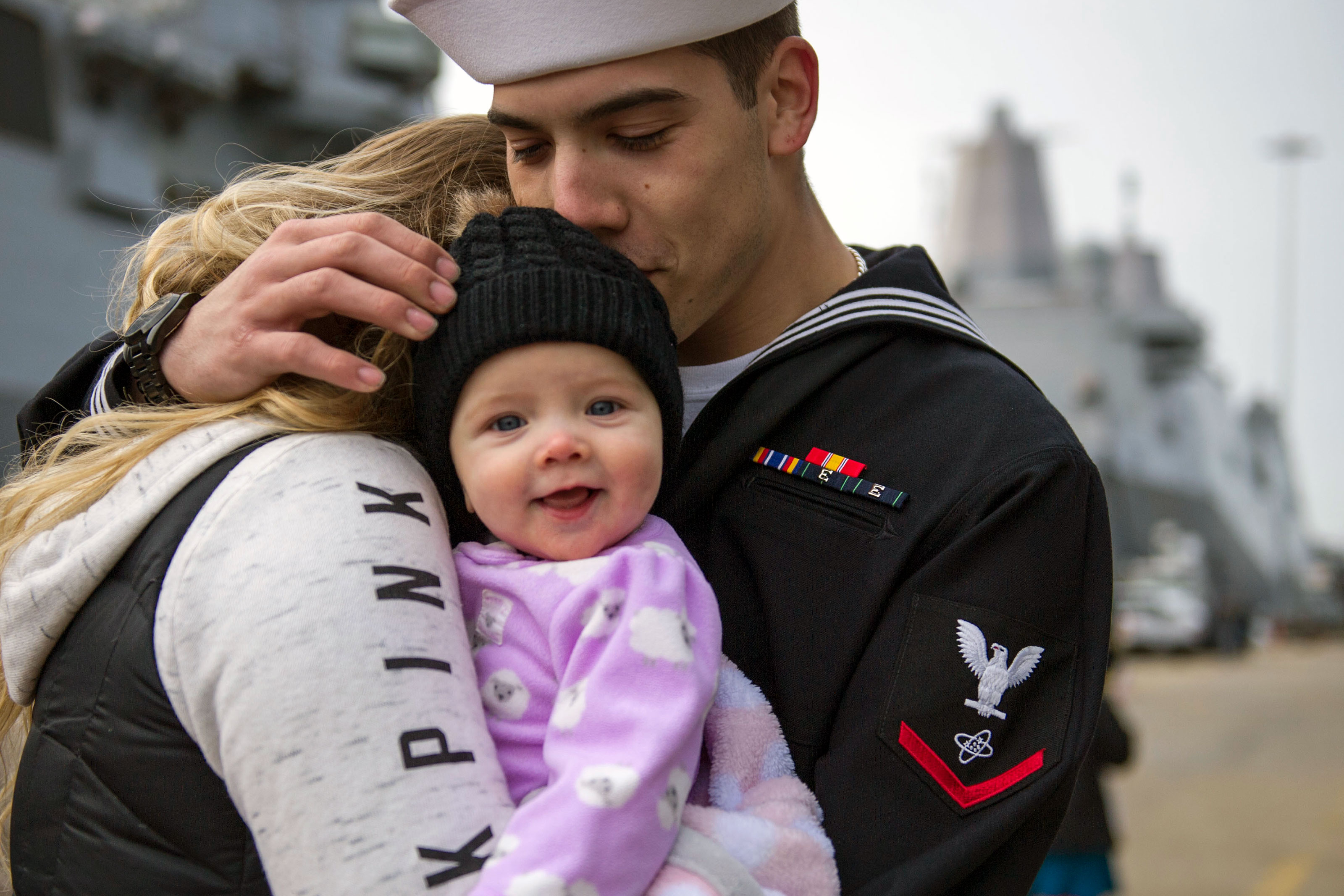 Electronics Technician 3rd Class Tyler Hernandez meets his child for the first time following the guided-missile cruiser USS Vella Gulf's (CG 72) return to homeport. (U.S. Navy/Justin Wolpert)