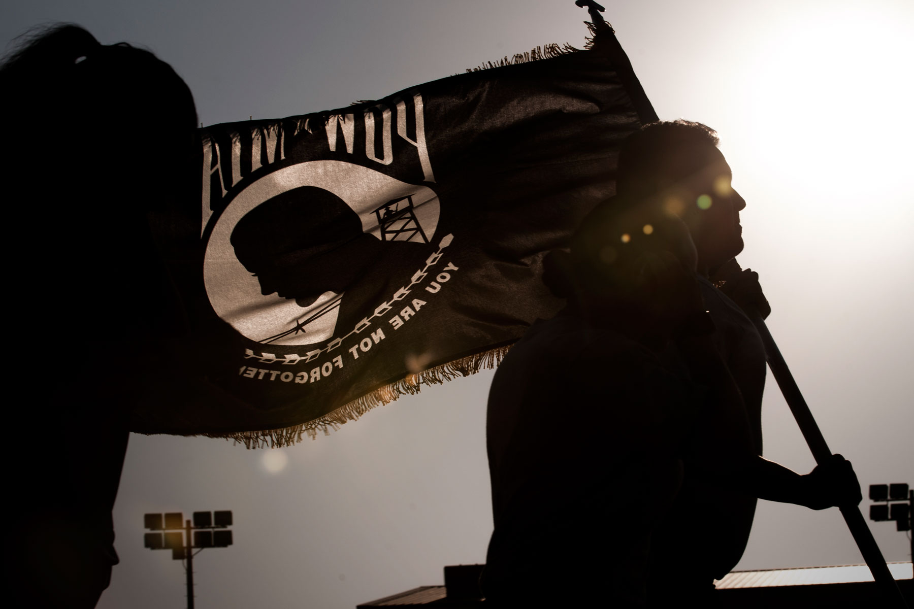 U.S. Air Force Airmen run with the Prisoner of War and Missing in Action flag during the POW/MIA Recognition Day at Kunsan Air Base, Republic of Korea, Sept. 14, 2017. (U.S. Air Force photo by Staff Sgt. Victoria H. Taylor)