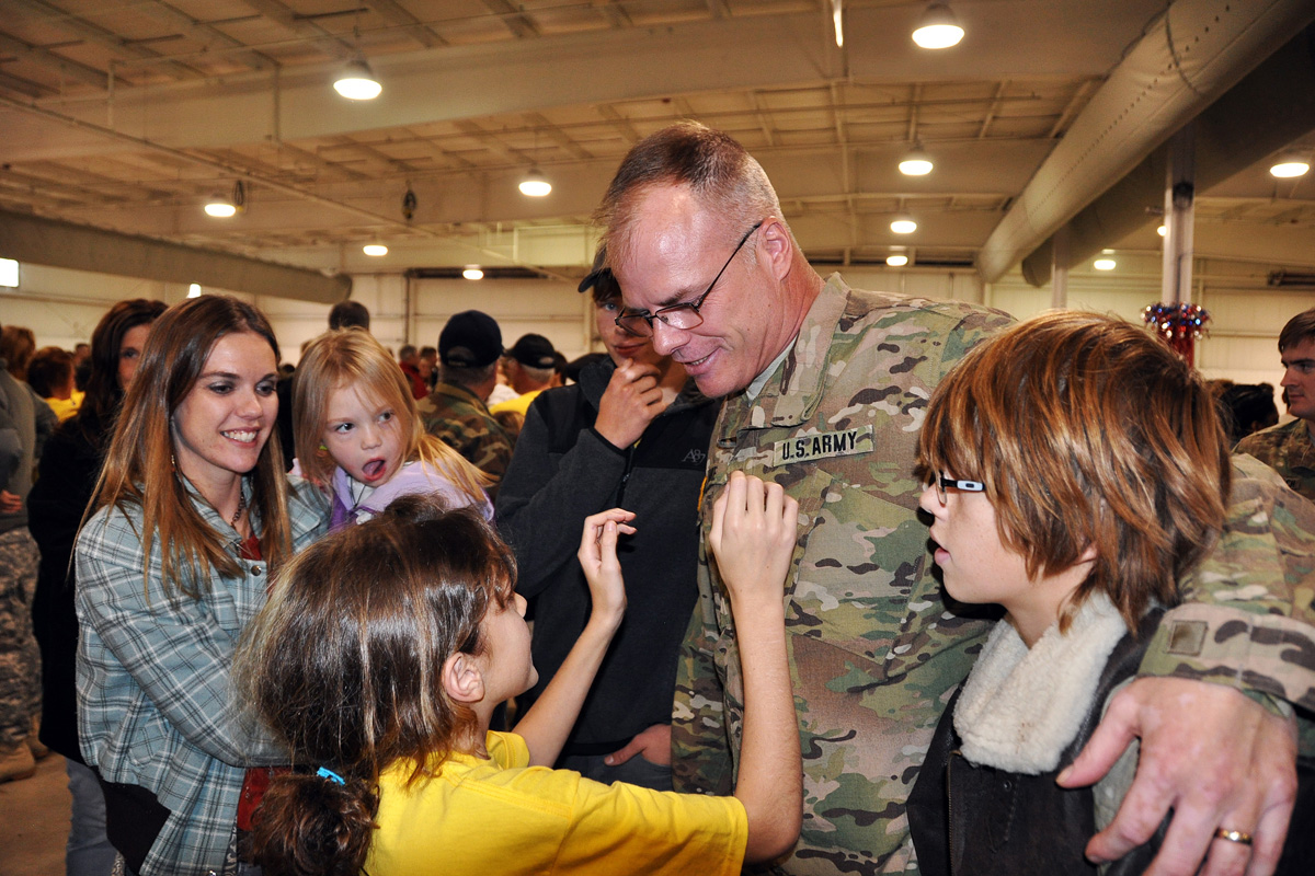 Army servicemember happy with family