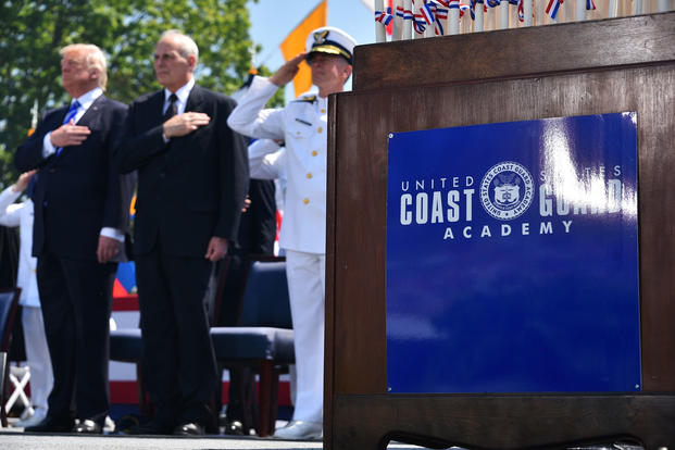 President Donald Trump, John Kelly, and Coast Guard Commandant Adm. Paul Zukunft render honors during the 136th Coast Guard Academy commencement exercise in New London, Conn., May 17, 2017. (Coast Guard photo/Petty Officer 2nd Class Patrick Kelley)