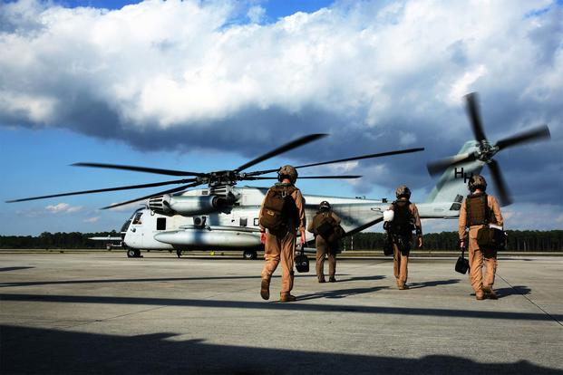 Pilots and crew members with Marine Heavy Helicopter Squadron 366 board a CH-53E Super Stallion at Marine Corps Air Station Cherry Point, N.C., Oct. 8, 2014. (U.S. Marine Corps/Cpl. J. R. Heins)