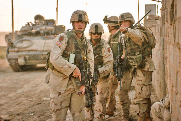 CPT Dean W. Morisson, Executive Officer with the 1st Infantry Divisions 3rd Brigade Reconnaissance Troop, directs SSgt. Nicholus Danielsen while conducting clearing operations in Fallujah Nov. 15, 2004, during Operation Al-Fajr. (1st Lt. Kimberly Snow)