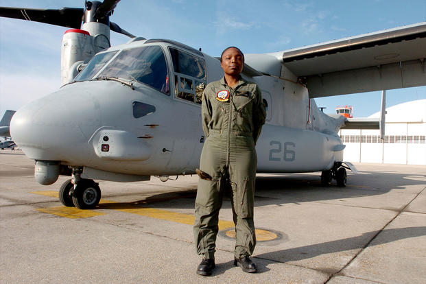 Marine Corps Captain Elizabeth A. Okoreeh-Baah poses in front of an MV-22 Osprey, March 14, 2006. (U.S. Marine Corps/Jonathan A. Tabb)