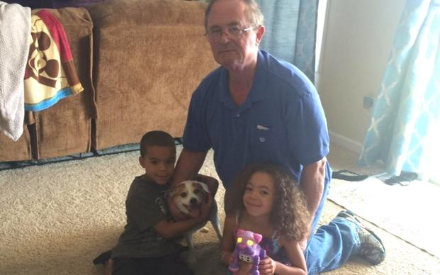 Veteran Bruce, his grandkids and his pup Molly. (Courtesy of Pets for Patriots)