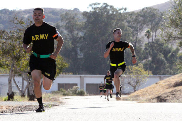 Sgt. George Ruiz, left, of the 49th Personnel Support Company, 115th Regional Support Group, California Army National Guard, battles Spc. Devon Witt to the finish line of the 2-mile run of the Army Physical Fitness Test. (Army National Guard/Eddie Siguenza)
