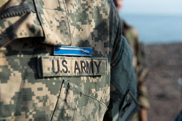 A soldier wears the Expert Infantry Badge after completing all the requirements. Nathan Maysonet/Air Force