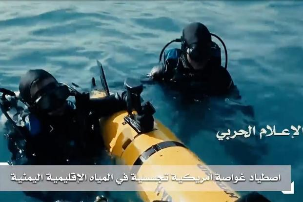Screen grab of video showing Houthi Navy celebrating with what appears to be a captured U.S. Navy underwater drone.