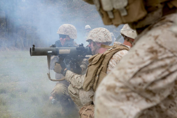 U.S. Marine Corps Lance Cpl. David Coker, center, assaultman, Alpha Company, 1st Battalion, 2nd Marine Regiment, 2nd Marine Division (MARDIV), fires a shoulder-launched multipurpose assault weapon during a platoon live fire attack as part of a deployment for training exercise on Fort A.P. Hill, Va., April 22, 2015. (U.S. Marine Corps photo/Alexander Hill)