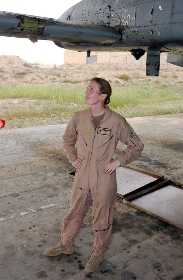 Then-Capt. Kim Campbell surveys the battle damage to her A-10 Thunderbolt II at a base in Southwest Asia. Captain Campbell's A-10 was hit over Baghdad during a close air support mission on April 7, 2003. At the time she was deployed with the 332nd Air Expeditionary Wing. (AF Courtesy Photo)