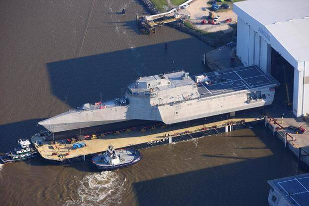 The future littoral combat ship USS Tulsa (LCS 16) is secured to the Crowley launch barge in preparation for the short journey down the Mobile River to BAE Ship Systems for the final stage of the launch process. (U.S. Navy photo)