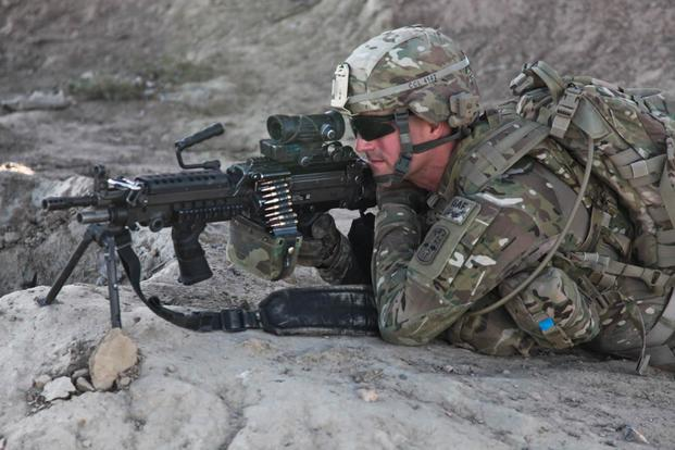 Soldier fires an M249 squad automatic weapon. (Army Photo)
