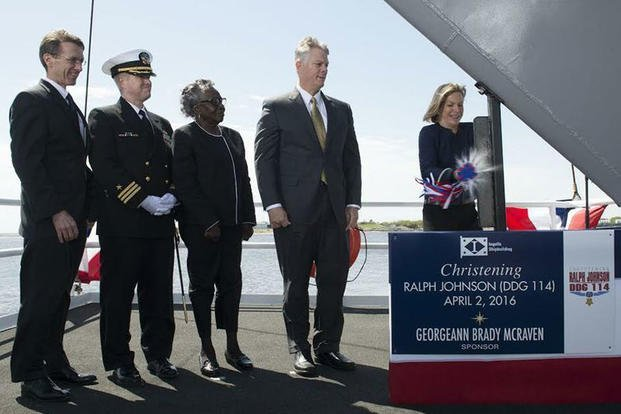Ship Sponsor Georgeann McRaven ceremoniously breaks a bottle of champagne on the bow during the christening ceremony for the future guided missile destroyer USS Ralph Johnson (DDG 114), April 2, 2016. The ship is named for Medal of Honor recipient Ralph Johnson. (U.S. Navy photo courtesy of Huntington Ingalls Industries)