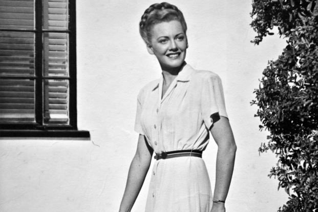 Betty Blake, 20 years old, stands in front of her family's home in Honolulu, Hawaii. Blake worked at the captain of the Navy yard's office and also flew tourists around the Hawaiian Islands as a commercial pilot before the attack on Pearl Harbor. (Courtesy photo)