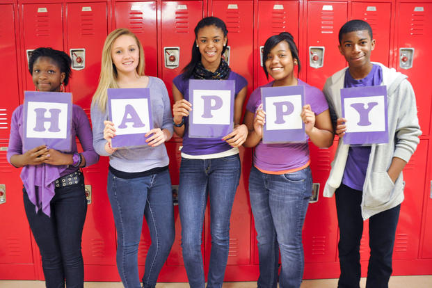 Military students celebrate Purple Up Day during Month of the Military Child. (DoDEA)