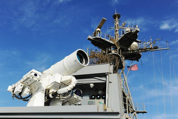 The Afloat Forward Staging Base (Interim) USS Ponce (ASB(I) 15) conducts an operational demonstration of the Office of Naval Research (ONR)-sponsored Laser Weapon System (LaWS) while deployed to the Arabian Gulf on Nov. 16, 2014. (U.S. Navy photo by John F. Williams)