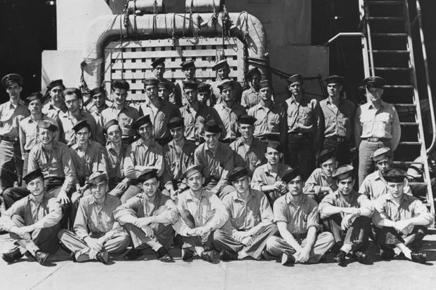 Members of the ship's crew pose in the well deck, during World War II. Photograph was taken prior to her final overhaul (completed in July 1945), as life rafts are of a different pattern than carried after that overhaul. Photograph was received by the Naval Photographic Science Laboratory on 24 August 1945. Official U.S. Navy Photograph, now in the collections of the National Archives.