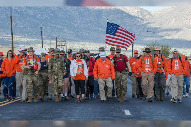 100-year-old Bataan Death March survivor Col. Ben Skardon (in white hat), a beloved Clemson University alumnus and professor emeritus, walked between 6.5 and 7 miles in the Bataan Memorial Death March at White Sands Missile Range, N.M., March 25, 2018. (Photo: U.S. Army/Ken Scar)