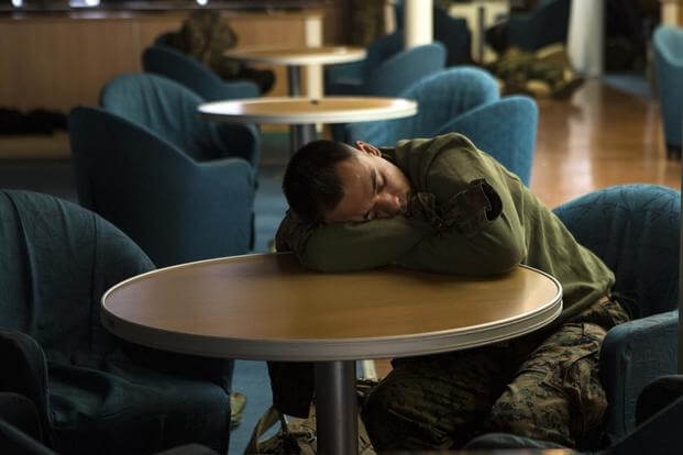U.S. Marines and sailors with III Marine Expeditionary Force (III MEF) find places to sleep and be comfortable to get rest before arriving to support Marine Expeditionary Force Exercise (MEFEX) 2014, March 9, 2014 (U.S. Marine Corps/Cpl. Sara A. Medina)