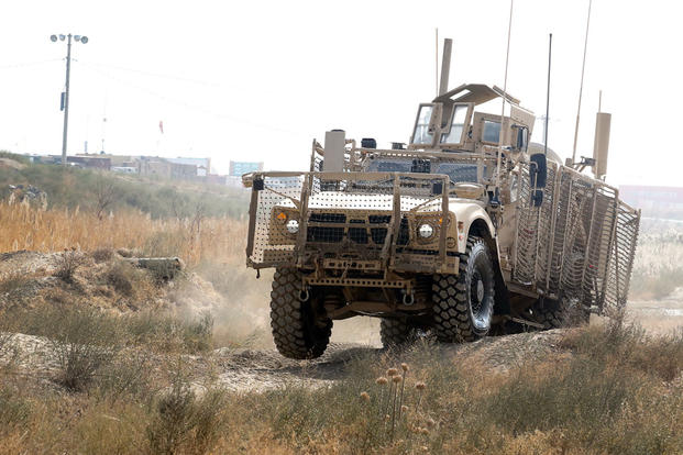 An Oshkosh Defense mine-resistant, ambush-protected vehicle All-Terrain Vehicle (MAT-V) bumps across ruts in the off-road portion of the master driver training course at Bagram Airfield, Afghanistan on Nov. 8, 2007. (U.S. Army photo/Elizabeth White)