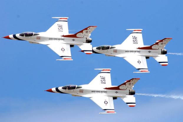"The U.S. Air Force Demonstration Squadron Thunderbirds practice their performance over Hickam Air Force Base, Hawaii, for the ""Wings Over the Pacific"" open house Sept. 18, 2009. (U.S. Air Force/Staff Sgt. Mike Meares)"