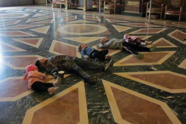 Five of the six Vankirk children lay on the Caserta Palace museum's floor. (Courtesy of Patrick Vankirk)