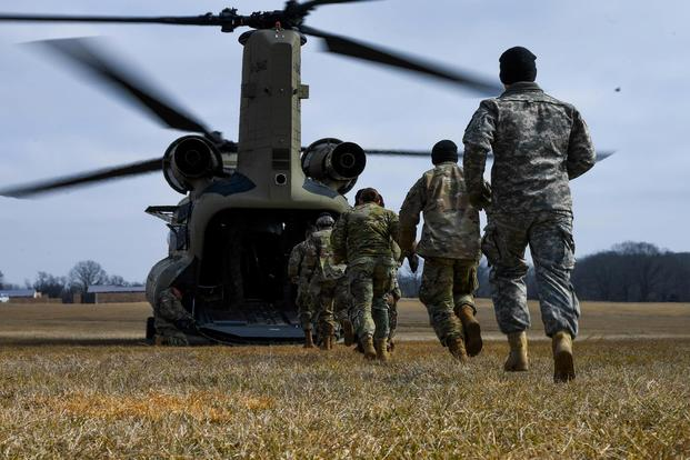 Soldiers with the 101st Combat Aviation Brigade, 101st Airborne Division (Air Assault), load equipment into a CH-47 Chinook helicopter in preparation to jump their tactical operations center (TOC) to a new location during Warfighter, a two-week command and control exercise Feb. 13, 2018, at Fort Campbell, Kentucky. (U.S. Army photo taken by Sgt. Marcus Floyd, 101st Combat Aviation Brigade)