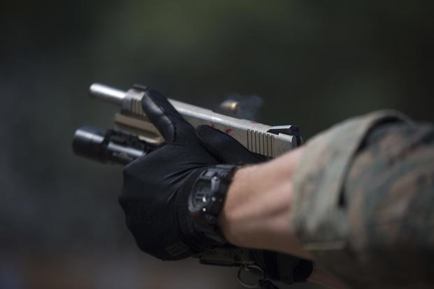A Force Reconnaissance Marine with Maritime Raid Force, 31st Marine Expeditionary Unit, fires an M1911 .45 caliber pistol in Guam, January 29, 2018, during Visit Board Search and Seizure training (U.S. Marine Corps/Cpl. Bernadette Wildes)