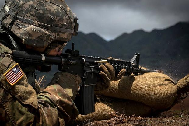 Spc. James Harris, assigned to 1st Brigade Combat Team, 25th Infantry Division, U.S. Army Alaska, zeroes his M4A1 carbine rifle on day one of the Pacific Theater Best Warrior Competition on June 12, 2017, at Schofield Barracks, Hawaii. (U.S. Army photo by Cpl. Michelle U. Blesam)