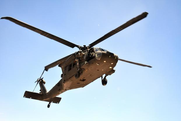 A Black Hawk helicopter assigned to 3rd Battalion, 501st Aviation Regiment, Combat Aviation Brigade, 1st Armored Division, at Fort Bliss carries soldiers  during a platoon air assault, movement-to-contact and ground infiltration exercise at the Doña Ana Training Complex, N.M., on March 11, 2018. Winifred Brown/Army