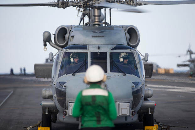"An MH-60R Sea Hawk helicopter assigned to the ""Swamp Foxes"" of Helicopter Maritime Strike Squadron (HSM) 74 prepares to take off from USS Gerald R. Ford's (CVN 78) flight deck. (Sean A Elliott)"
