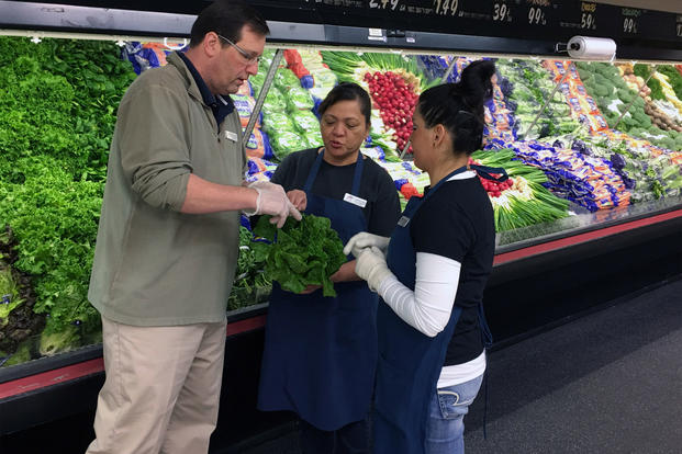 Commissary employees and Nellis Air Force Base undergo produce training. (Defense Commissary Agency)