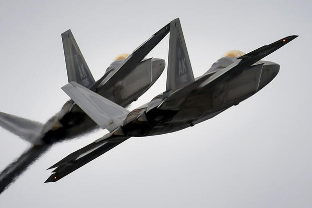 Two F-22 fighter jets from the 3rd Wing at Joint Base Elmendorf-Richardson, Alaska, conduct approach training in March 2016. (US Air Force photo/Justin Connaher)
