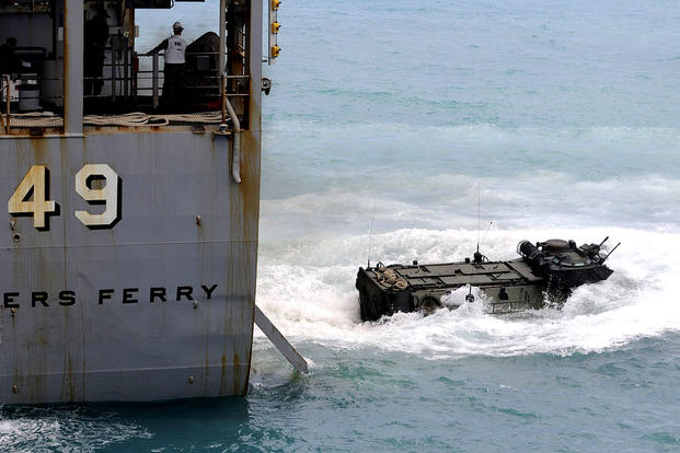 The amphibious dock landing ship Harpers Ferry launches an amphibious assault vehicle. The warship's skipper was relieved of duty after 14 months in command. Geronimo Aquino/Navy