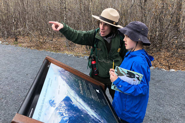 Kenai Fjords National Park Ranger CJ explains the Exit Glacier's recession to a military kid during a Kids to Parks Blue Star Families event in Alaska. (Military.com/Amy Bushatz)