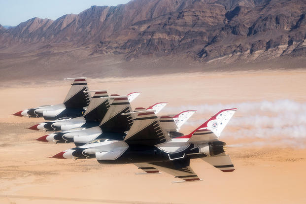 The Thunderbirds Diamond formation pilots perform the Echelon Pass in Review maneuver over the Nevada Test and Training Range during a training flight, Jan. 29, 2018. (U.S. Air Force photo/Christopher Boitz)