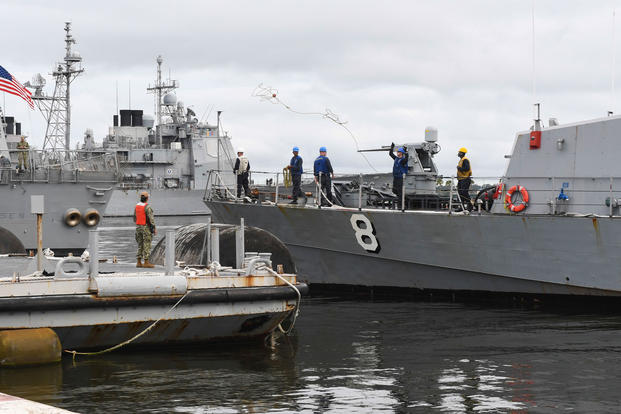 Sailors prepare to moor the Cyclone-class coastal patrol ship USS Zephyr (PC 8) to a barge at Naval Station Mayport following a four-month deployment, May 14, 2018. (U.S. Navy photo/Michael Lopez)