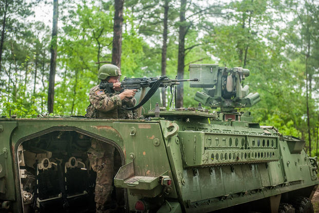 A U.S. Army Infantry soldier-in-training assigned to Alpha Company, 1st Battalion, 19th Infantry Regiment, 198th Infantry Brigade, engages the opposing force (OPFOR) May 2, 2017, with a M249 Squad Automatic Weapon (SAW) on a Stryker to provide support-by-fire during a squad training exercise. (U.S. Army photo/Patrick A. Albright)