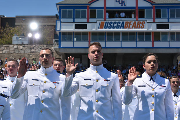 New ensigns in the Coast Guard take the Oath of Office during the 136th Coast Guard Academy commencement exercise in New London, Conn., May 17, 2017.  (Coast Guard photo/Patrick Kelley)
