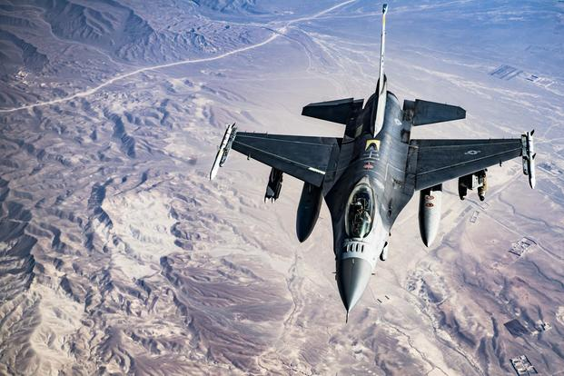 A U.S. Air Force F-16C Fighting Falcon pilot maneuvers into position to conduct refueling operations with a KC-135 Stratotanker over Afghanistan in support of Operation Freedom's Sentinel, March 11, 2018. (U.S. Air Force/Tech. Sgt. Gregory Brook)