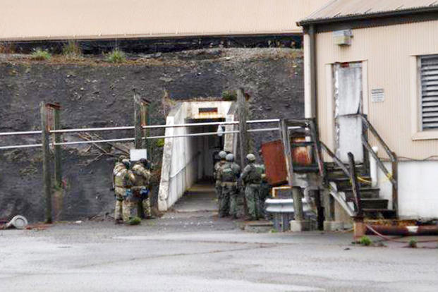 Virginia State Police prepare to breach a door during Weapons of Mass Destruction exercise at Radford Army Ammunition Plant, April 22, 2017. (U.S. Army photo/Charlie Saks)