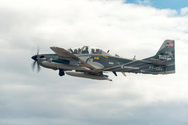 An Embraer EMB 314 Super Tucano A-29 experimental aircraft flies over White Sands Missile Range. The A-29 is participating in the U.S. Air Force Light Attack Experiment (OA-X), a series of trials to determine the feasibility of using light aircraft in attack roles. (Ethan D. Wagner/U.S. Air Force)