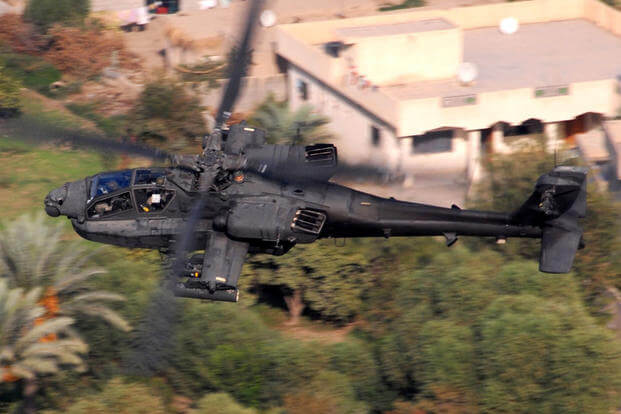 An AH-64D Apache from Company B, 1st Attack Battalion, 227th Aviation Regiment, 1st Air Cavalry Brigade, 1st Cavalry Division, flies over a residential area in the Multi-National Division-Baghdad area Oct. 12, 2007. (Photo: U.S. Army/Chief Warrant Officer 4 Daniel McClinton)