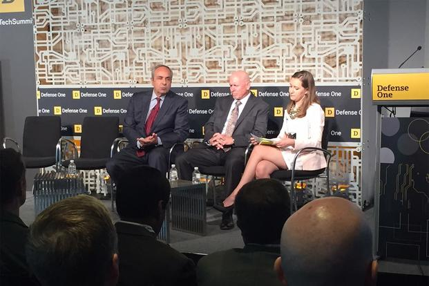 Richard J. Joseph, left, the Air Force's chief scientist, and Mark Tapper, center, a special advisor on intelligence, surveillance and reconnaissance at the service, speak to Military.com's Oriana Pawlyk at the Defense One Tech Summit in Washington, June 26, 2018. (DoD photo by Jim Garamone)