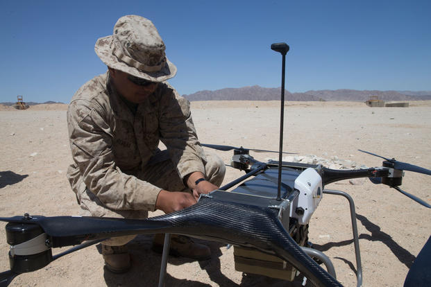 U.S. Marine Corps Lance Cpl. Miguel Rivera, with Combat Logistics Battalion 8, Combat Logistics Regiment 2, 2nd Marine Logistics Group, performs a pre-flight test on the TRV-50 quadcopter during an operations check for Marine Corps Warfighting Laboratory as part of Integrated Training Exercise 3-18 on Marine Corps Air Ground Combat Center, Twentynine Palms, Calif., April 29, 2018. (U.S. Marine Corps photo/Scott Jenkins)
