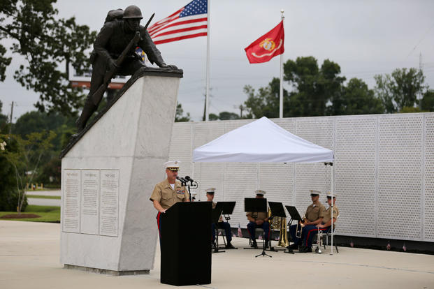U.S. Marine Corps Col. David P. Grant, commanding officer of Marine Corps Combat Service Support Schools, speaks to guests during the 8th Annual Montford Point Marine Day Congressional Gold Medal Ceremony at the Memorial Gardens in Jacksonville, N.C. on Aug. 24, 2017. (U.S. Marine Corps photo/Laura Mercado)
