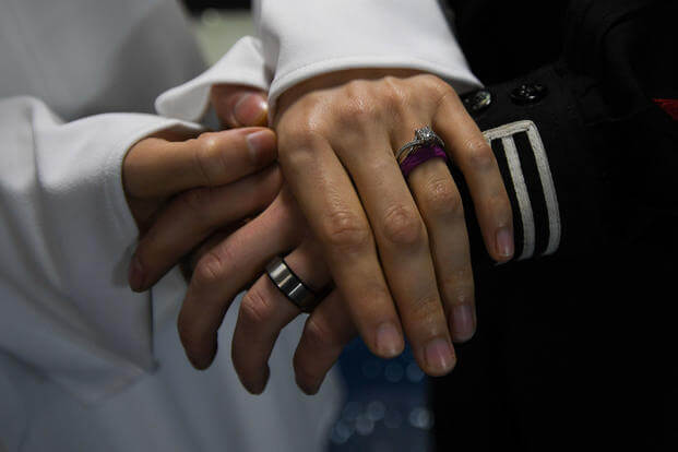Electrician's Mate 2nd Class Michael Feola and his bride are wed in the chapel aboard USS John C. Stennis (CVN 74), Feb. 1, 2018. (U.S. Navy photo/William Ford)