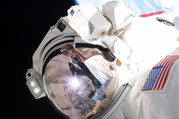 Astronaut Chris Cassidy takes the coolest profile picture while on a space walk during his mission to the International Space Station. NASA and the Air Force are teaming up to develop technologies to make much longer space voyages possible. NASA photo