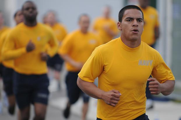 Sailors assigned to the forward-deployed amphibious assault ship USS Essex (LHD 2) participate in command physical training in Sasebo, Japan, in 2011. The Navy is phasing out this version of the PT uniform. (U.S. Navy photo by Mass Communication Specialist 3rd Class Adam M. Bennett)