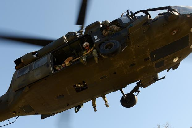 U.S. sailors assigned to Naval Special Warfare Group Two use a Fast Rope Insertion Extraction System in a training exercise in the Boeblingen Local Training Area, Germany, on April 22, 2015. (U.S. Army photo by Visual Information Specialist Jason Johnston)