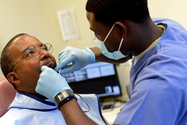 FILE PHOTO -- Regie Dawkins, U.S. Air Force retired, receives a dental examination. (U.S. Air Force/Airman 1st Class Jenay Randolph)